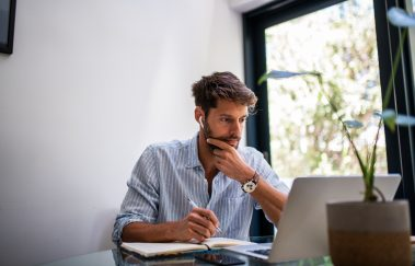 man studying for real estate license exam